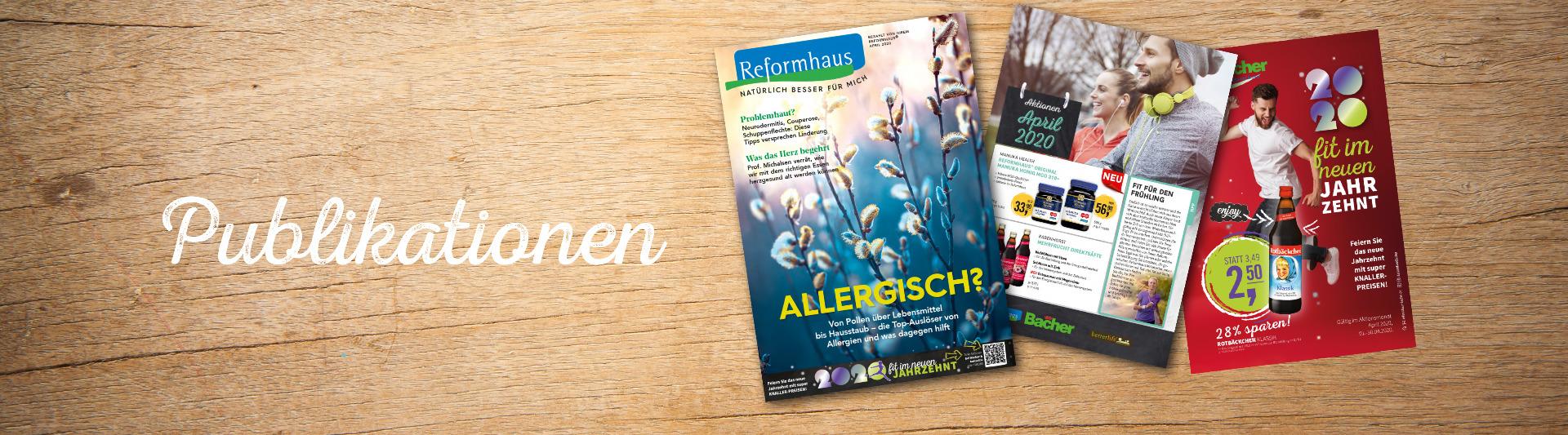 April20 Publikationen auf Holzhintergrund